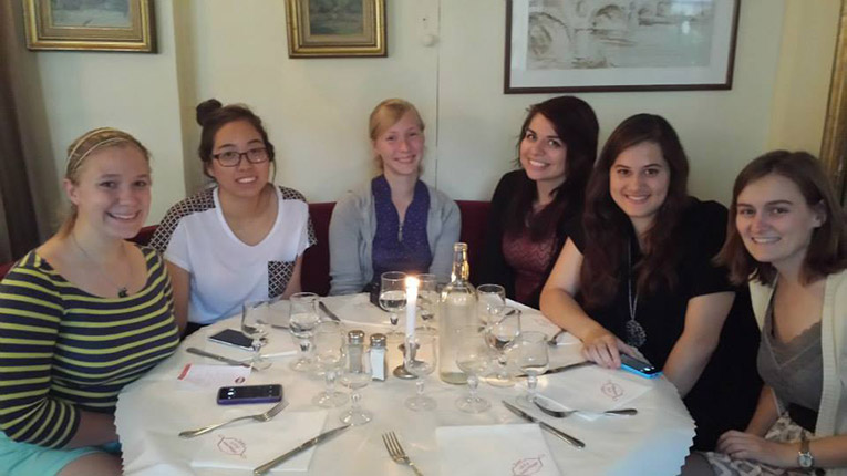 Study abroad students having dinner in Paris, France