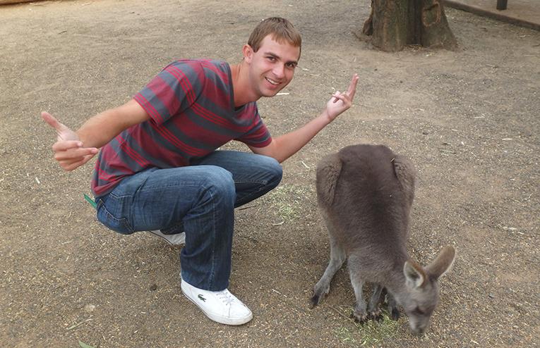 Tourist with a kangaroo in Australia