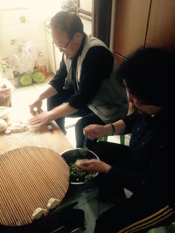 Chinese couple making dumplings