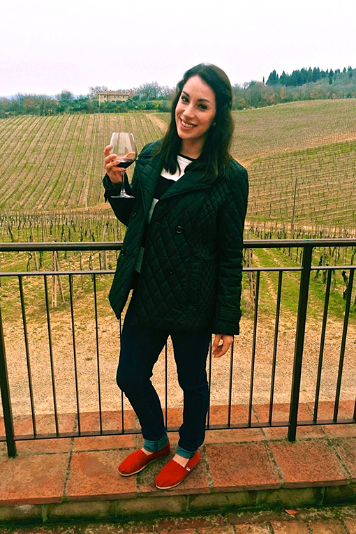 Girl holding a glass of wine in Tuscany, Italy