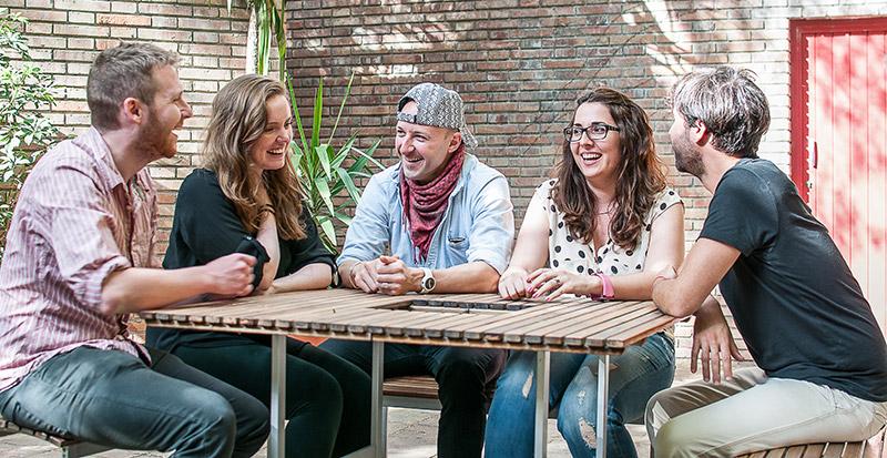 Oxford TEFL staff enjoying a lunch break on the patio in Barcelona