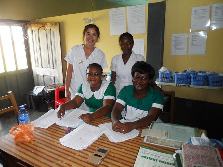 International intern with hospital staff in Ghana