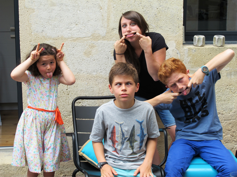 Aupair making faces with children