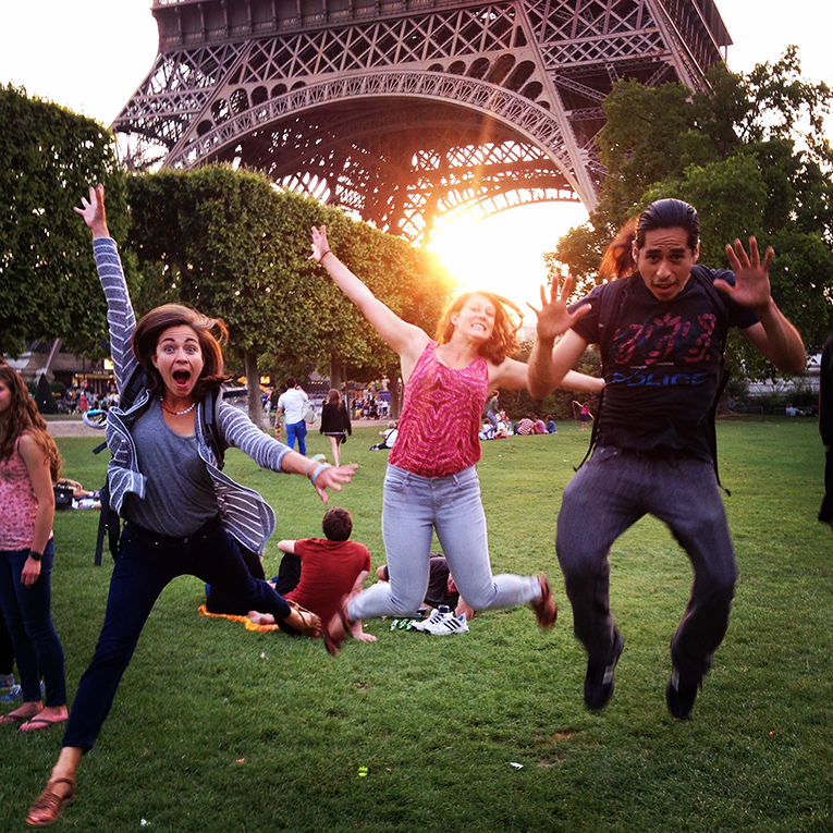 tourists jump in front of the Eiffel Tower, Paris