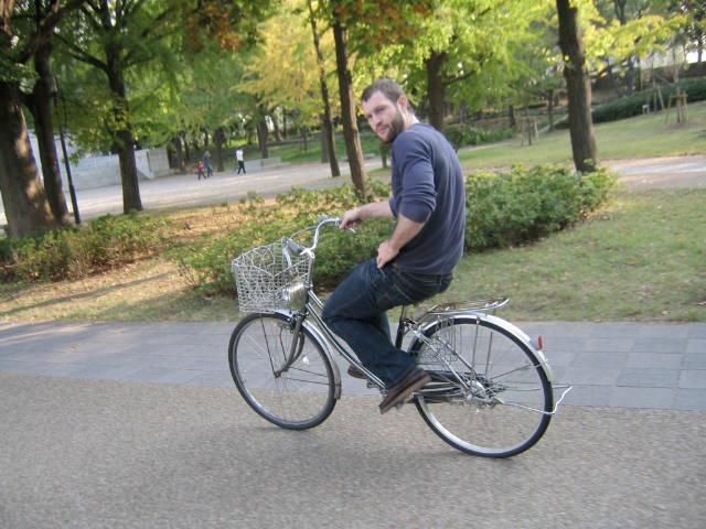 ESL teacher riding a bicycle