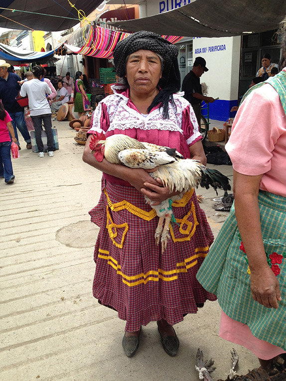 Zapotec woman with a chicken at the SUnday Tlacolula market in Oaxaca