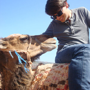 A student riding a camel
