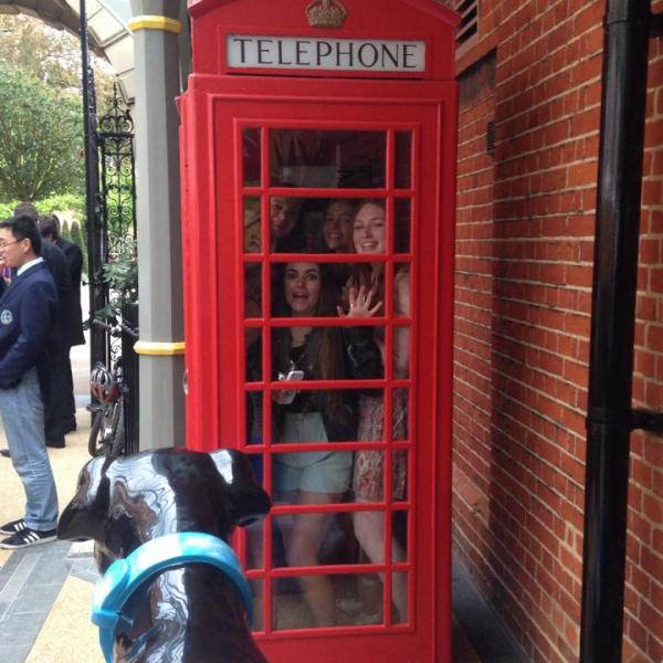 Photo of young people in a red telephone box in England