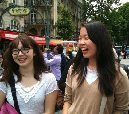 Girls happily exploring the streets of Paris