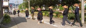 monks crossing the road