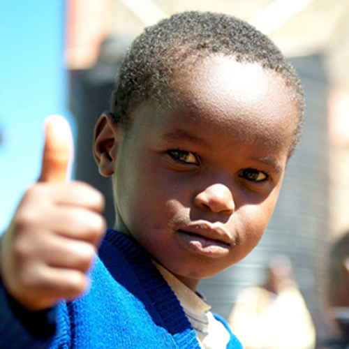A child giving a thumbs up