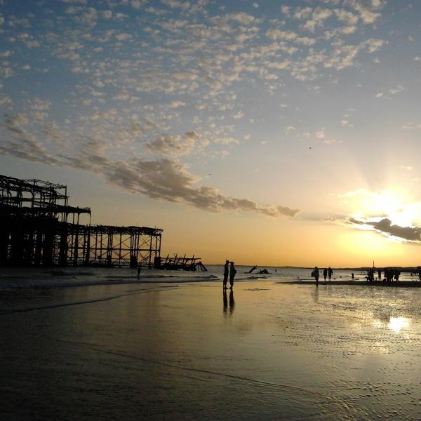 Brighton ocean and West Pier at Sunset