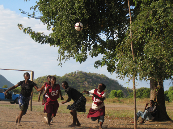 African teenagers playing soccer