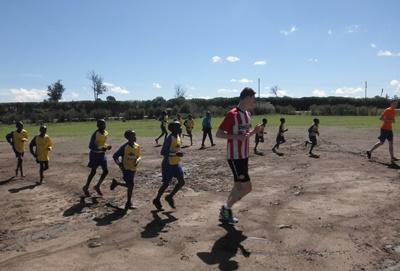 A volunteer running drills with his students in Kenya