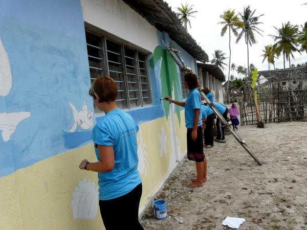 Volunteers painting the walls of the school