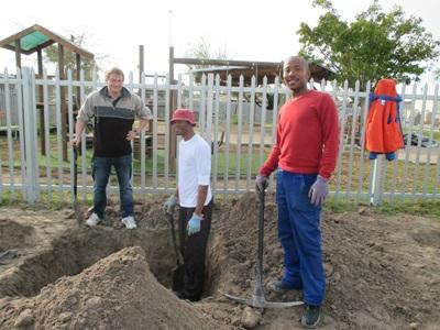 Projects Abroad Farming volunteers digging irrigation canals in Cape Town, South Africa