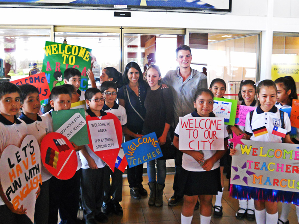 Volunteers welcomed to Arica by their students.