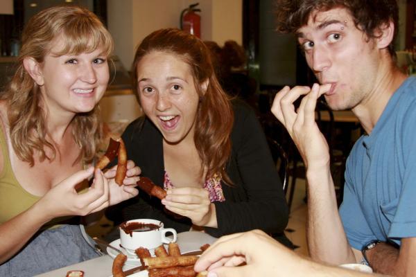 study abroad students enjoying churros in salamanca spain