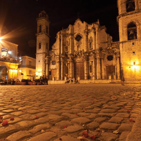 Cobblestone square and beautiful building in Cuba