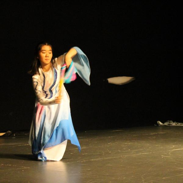Young Chinese girl giving a performance of traditional dance from her cuilture