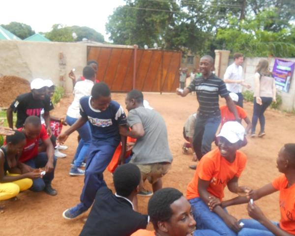 A photo of volunteers playing an HIV/AIDS educative game in Victoria Falls