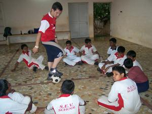 Coach Football to Children in India | travellersworldwide.com