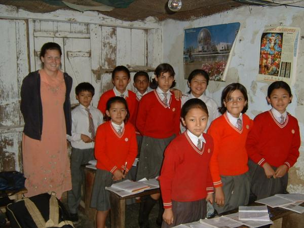 HELP volunteer with her students