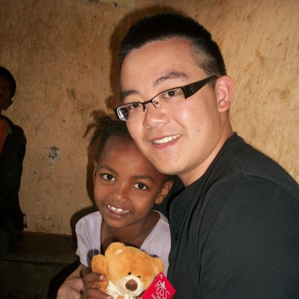 Volunteering with child on a mission trip in Ethiopia, Africa