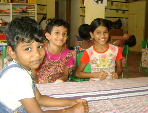 Volunteer with children at an orphanage in Colombo Sri Lanka