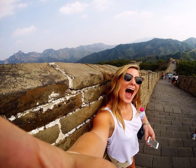 A woman taking a selfie on the Great Wall of China