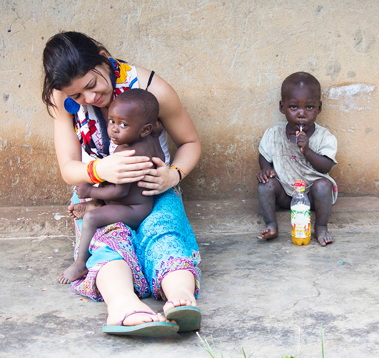 A girl with two African kids