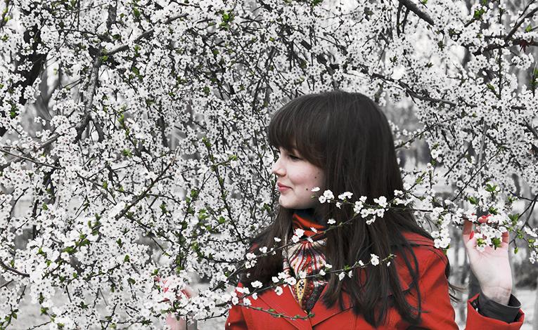 A woman under a cherry tree, cherry blossom