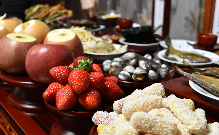 Closeup of a table decorated with many foods for feasting