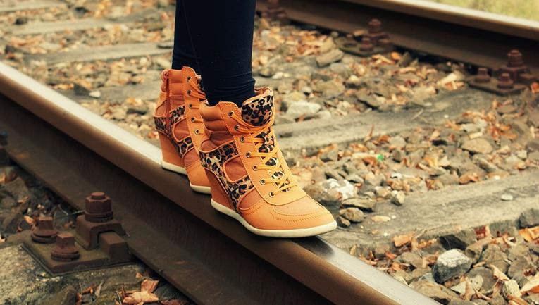 A girl walking on a railway