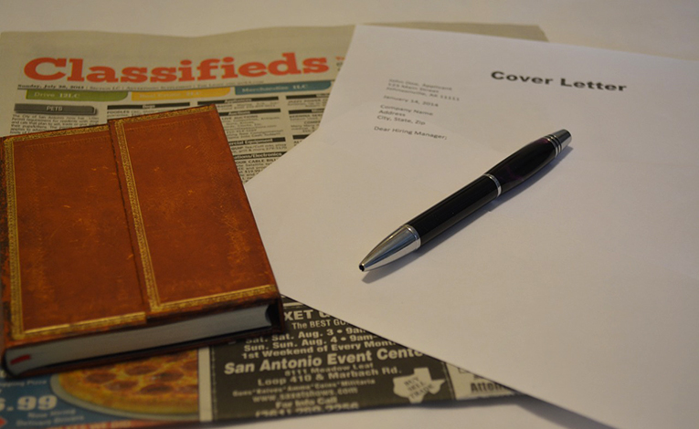 Job hunting with cover letter and notebook