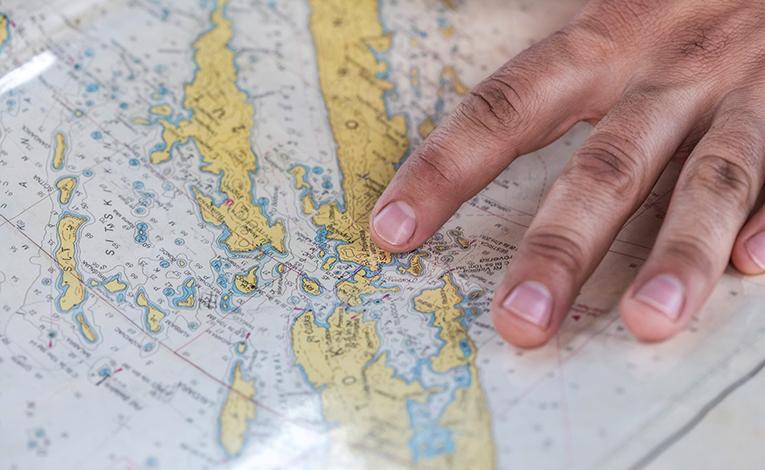 hand running along a world map