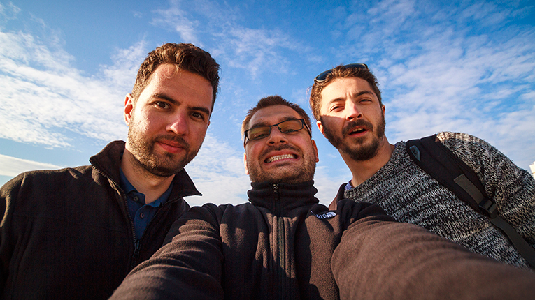 Three guys having a photo