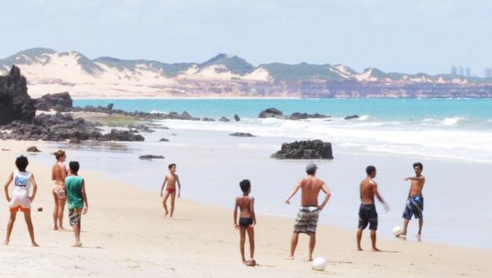 Play soccer on the beach with the locals while volunteering in Brazil.