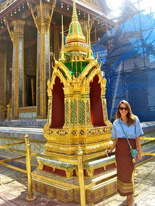 At the Grand Palace in traditional Thai clothing.