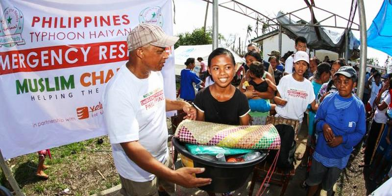 Handing out Relief Packages after Typhoon Haiyan in the Philippines.