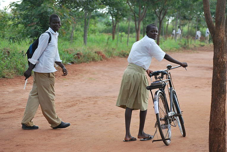 Ugandan teens riding bikes