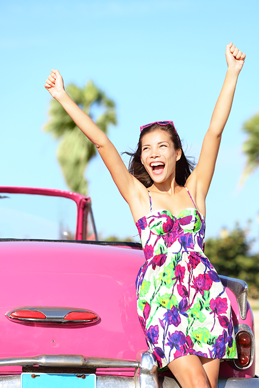 Girl excitedly holding her arms up in the air