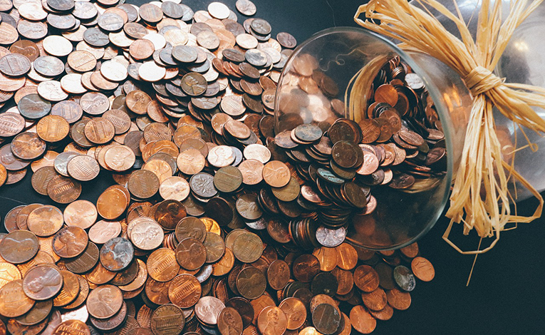 Pennies spilling out of a jar.