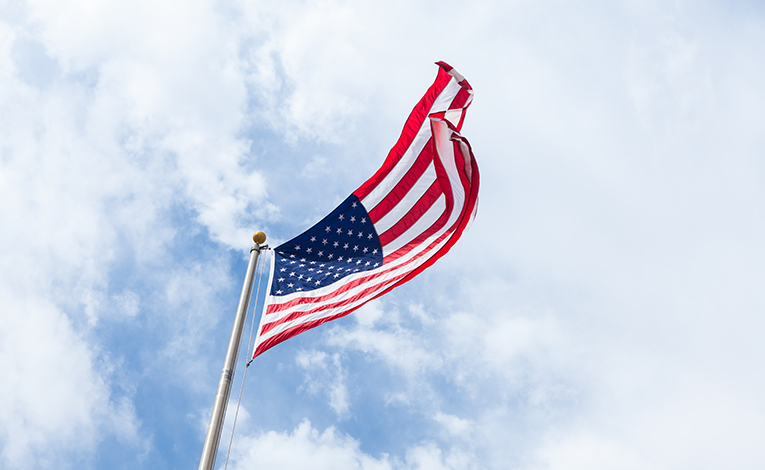 U.S. flag waving in the sky