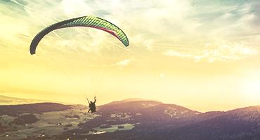A person paragliding.