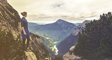 Woman trekking on top of a mountain