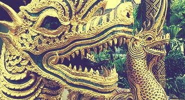 Golden dragon statues lining the steps of Doi Suthep in Chiang Mai, Thailand
