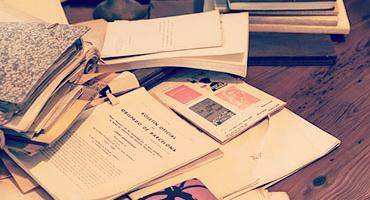 A pile of antique and old materials and books
