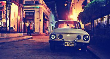Old car on a city street in Cuba