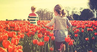 Girls in a field of tulips